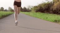 SLO MO TS Female runner enjoying her daily run video