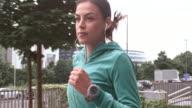 SLO MO TS Female runner listening to music video