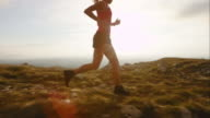 TS SLO MO female runner on mountain top video