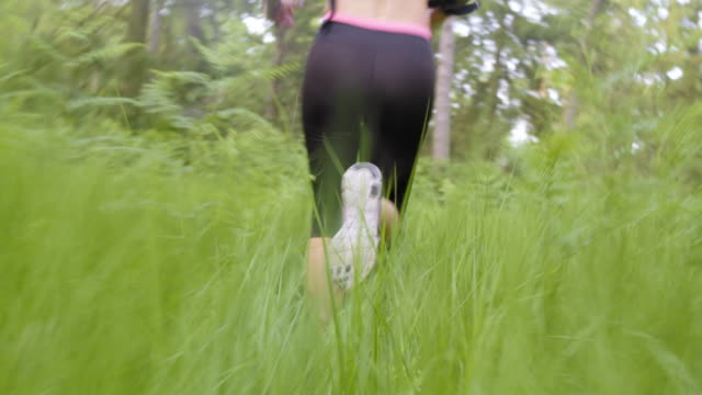 TS Female runner running across high grass video