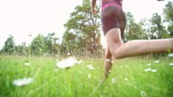 SLO MO Female runner running through high grass video