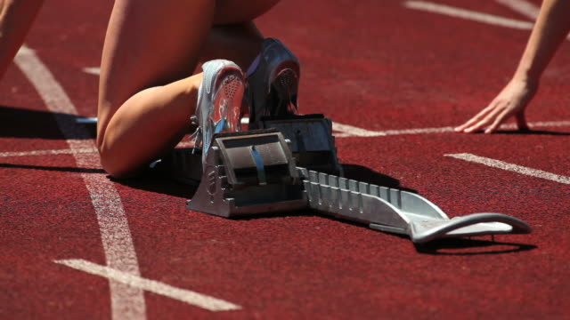 Female Runner Sprinting Off Starting Block video