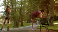 DS Female runner stretching on park bench video