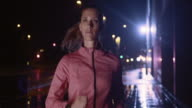 SLO MO Female running in the city at night video