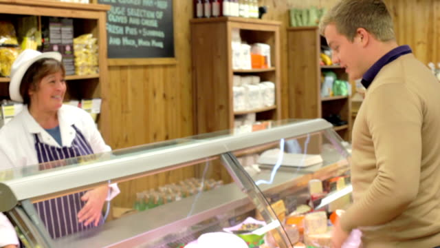 Female Sales Assistant Serving Customer In Delicatessen video