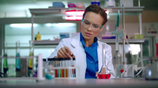Female scientist working at the laboratory. Worker doing laboratory research video