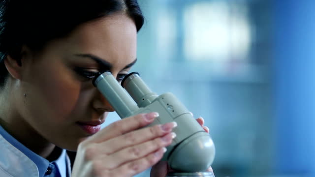Female Scientists Using Microscopes video