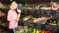 Female shopping grocery in organic shop video