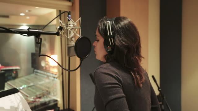 Female singer recording Vocals at Studio video