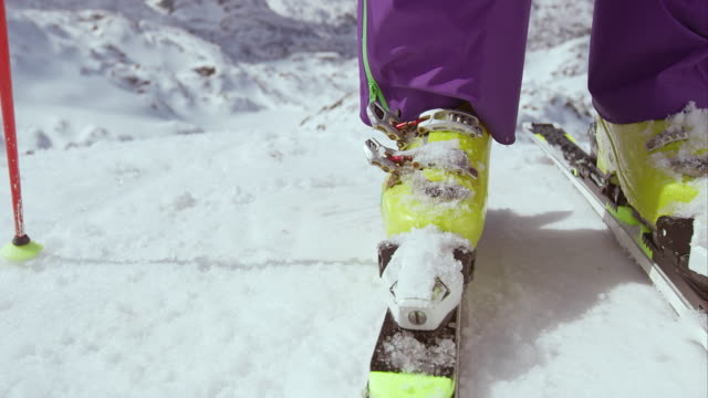 SLO MO Female skier closing the boot buckles video