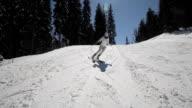 Female skier go down on ski route video