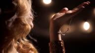Female smoke vaper, inhale and exhale vapor, huge cloud envelop hand, woman play, smile. Stream video