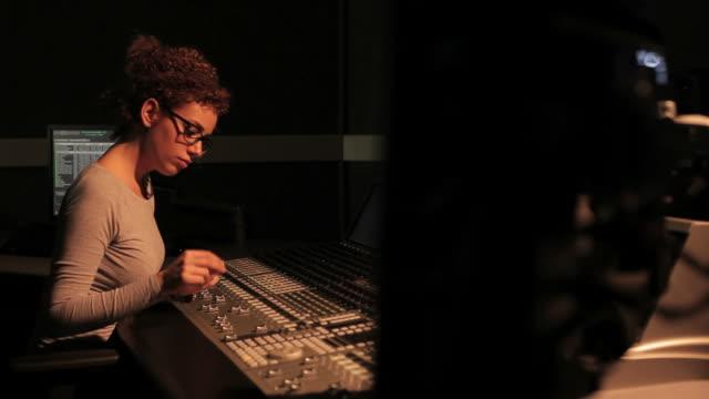 Female sound technician working in recording studio video