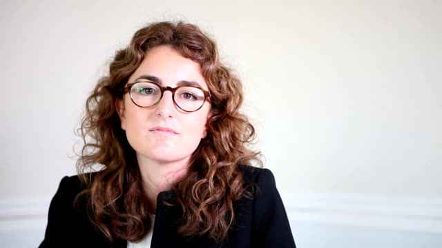 Female spanish lawyer listening to client video