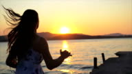 Female Sprinting Beach Pier Sunset Slow Motion Holiday Concept video