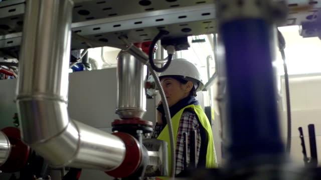 Female stationary engeneer at work video