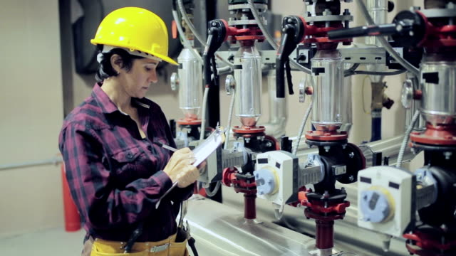Female stationary engineer at work video