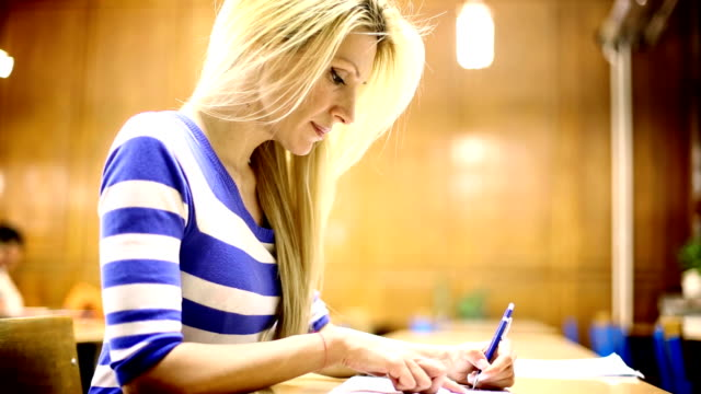 Female student in class. video