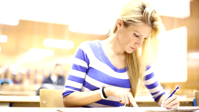 Female student in class. video