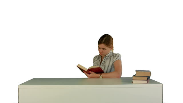 Female student reading a book for finding information on white background isolated video