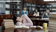 Female Student Sleeping in Library video