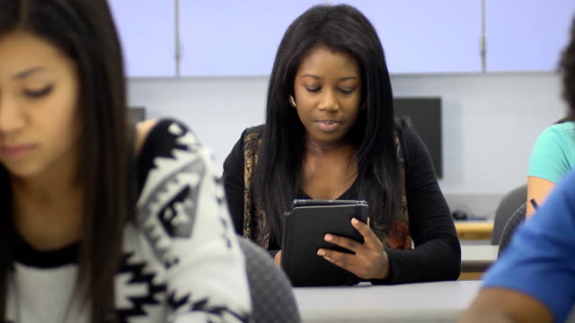 Female Student use Digital Tablet Computer video