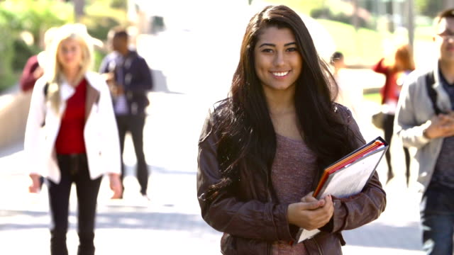 Female Student Walking Outdoors On University Campus video