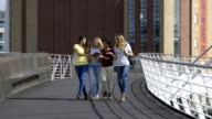 Female Students using Technology while Walking video