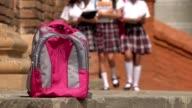 Female Students Walking Towards Backpack video