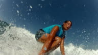 Female surfer riding waves video