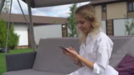 female surfing internet on the telephone video