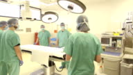 Female Surgeon Briefs Surgical Team at Operating Table video
