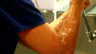 Female Surgeon Rinses Arms After Scrubbing video