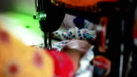 Female tailor working on sewing machine video
