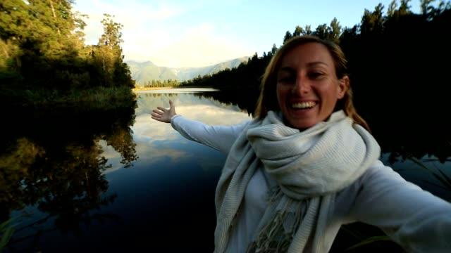 Female takes self portrait at lake Matheson, NZ video