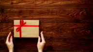 Female taking away a wrapped box with present video