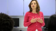 Female Teacher Interacting with Group of Students video