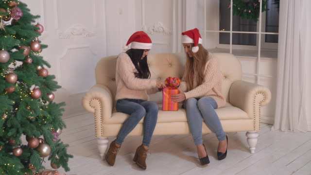 Female tearing wrapping paper on present video