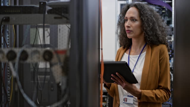 Female technician doing a checkup in the server room video