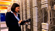 Female technician using digital cable analyzer video