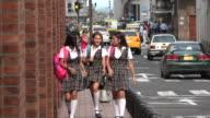Female Teen Students Walking Downtown video