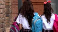 Female Teen Students With Backpacks video