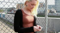 Female Teenager texting on mobile phone video