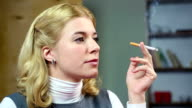 Female thinking about her life and smoking a cigarette. Unhealthy video