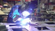 Female TIG welder working in workshop video