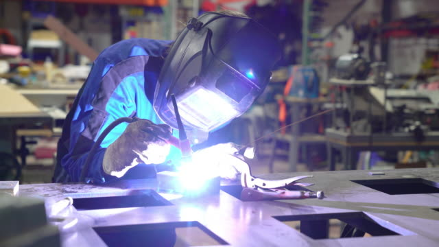 Female TIG welder working in workshop video