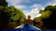 Female tourist kayaking on river, vacation, sport, slow motion video