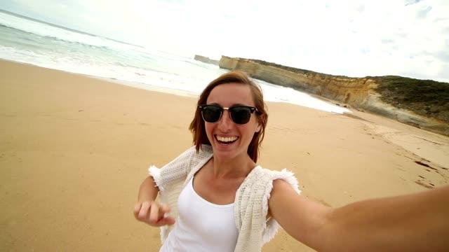 Female tourist takes selfie portrait at the Twelve apostles video