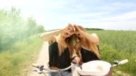 female twins making a heart symbol with her hands. hd. summerfeeling video