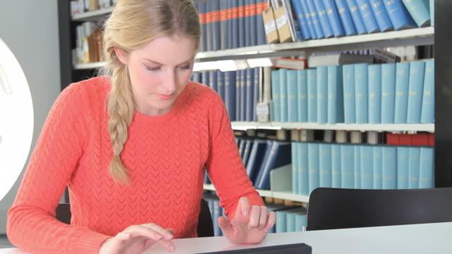 Female typing on ipad video